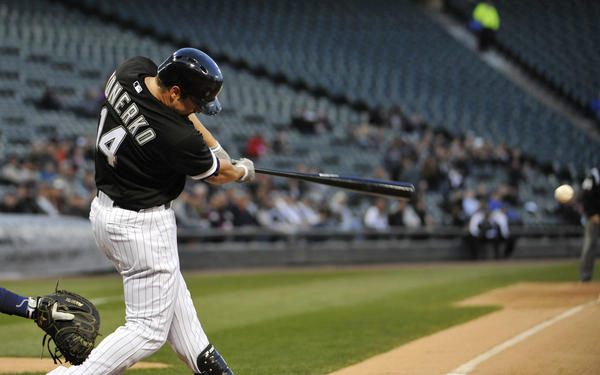 Paul Konerko hits an RBI single against the Rays during the first inning.