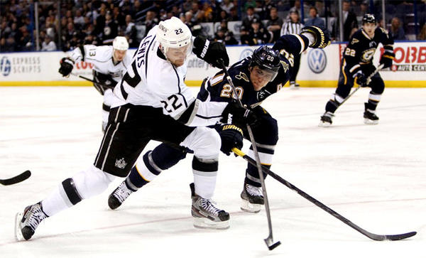 Los Angeles Kings center Trevor Lewis (22) shoots while being defended by St. Louis Blues left wing Alexander Steen.