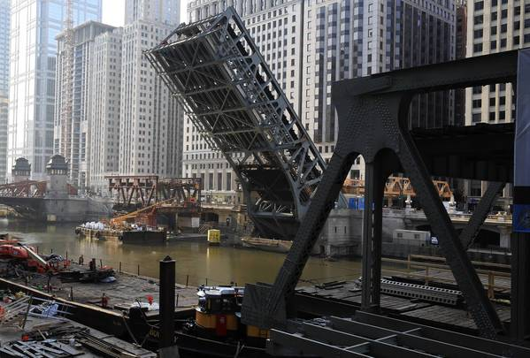 Part of the Wells Street Bridge is raised during the second phase of reconstruction, which began Friday and runs through May 6.