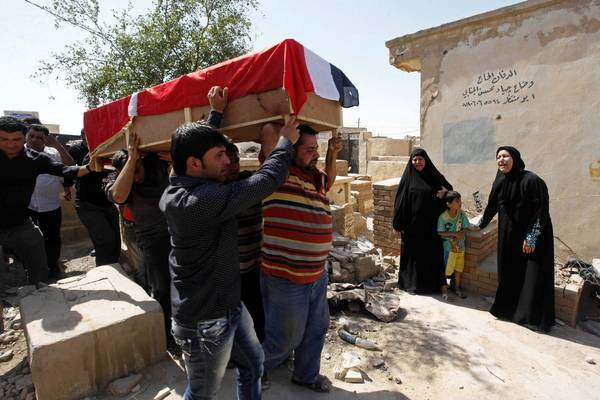 A bombing victim, Bashar Muhsin, 28, is taken for burial in Najaf, south of Baghdad.