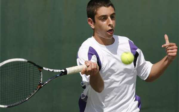 Hoover's Emile Ohanyan returns with a forehand shot in a Pacific League boys singles tennis prelims match at Pasadena High School on Monday, April 29, 2013.