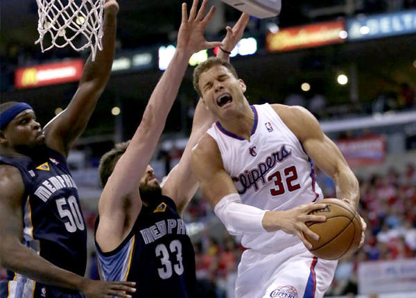 Clippers forward Blake Griffin struggles to drive past Grizzlies big men Zach Randolph (50) and Marc Gasol (33) late in Game 2.