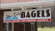 An unusual contest helped a Bedford bagel shop find new owners. Now, they're savoring their first anniversary since taking over the business.