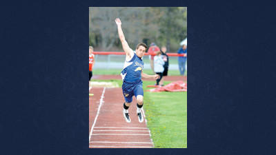 Shade's Brock Medva competes in the boys long jump on Monday.