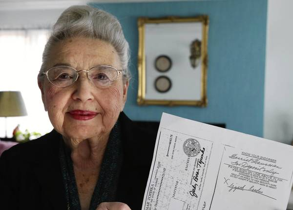 Harriet Hausman, of River Forest, holds a copy of her state tax refund check, which was stolen and cashed by someone else.
