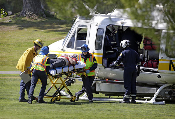 A victim is taken to a rescue helicopter on the Westlake Golf Course after a Cessna 172 emergency landed on the third fairway after a midair collision.