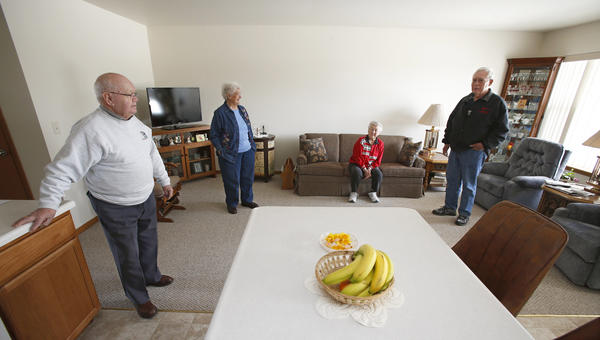 Standing in their new home, Andy, far left and Irma Koerner, left, talk with their neighbor Dianna Cooper, center and Arlo Bertsch, of the Eureka Housing Redevelopment Commission. The Koerners and Cooper are living in the newest homes built for the commission. American News Photo by John Davis