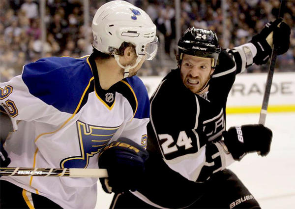 Kings' Colin Fraser (24) battles St. Louis Blues' Kevin Shattenkirk in the first period of Game 3 of the Western Conference semifinals last season.