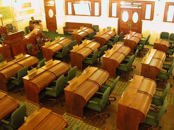 Legislators' chairs must be repaired rather than replaced because they are considered to be historic replicas.Senate chairs are green, House chairs are off-red.
