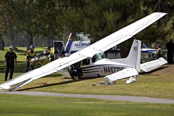Emergency crews respond to the scene where a Cessna 172 was forced to land on a fairway at Westlake Golf Course after a midair collision with another Cessna. The three people in this plane sustained non-life-threatening injuries; the pilot of the other aircraft died.