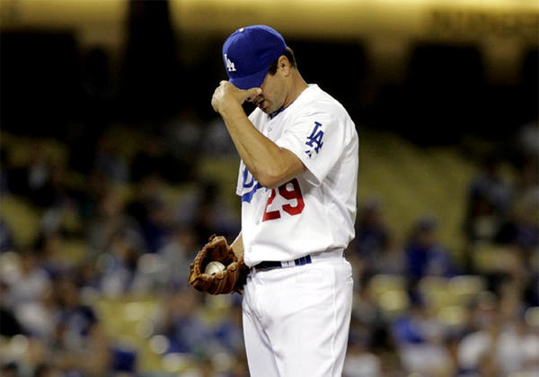 Dodgers' Ted Lilly gave up five runs (four earned) on eight hits over three innings.