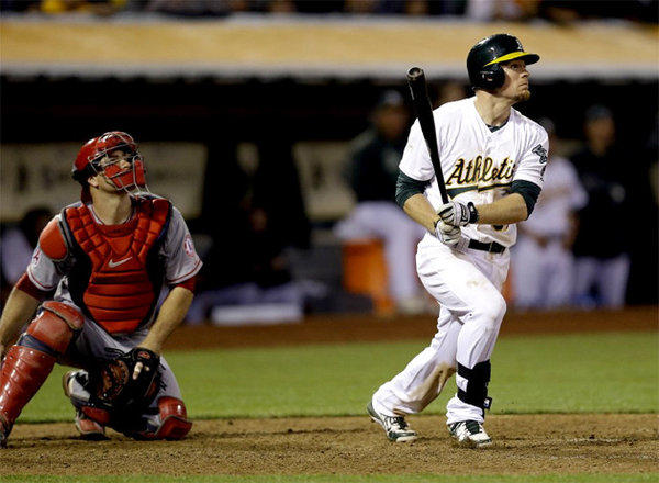 Oakland Athletics' Brandon Moss steals second base during the second inning. He hit a game-winning, two-run home run in the 19th inning.