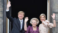 LONDON -- With an exchange of smiles and the flourish of a pen, Queen Beatrix of the Netherlands abdicated the throne and her son Willem-Alexander took her place Tuesday to become the country's first king in more than a century.