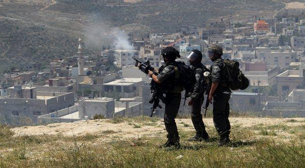Israeli border police fire tear gas at Palestinian villagers during clashes with Jewish settlers near the West Bank city of Nablus.