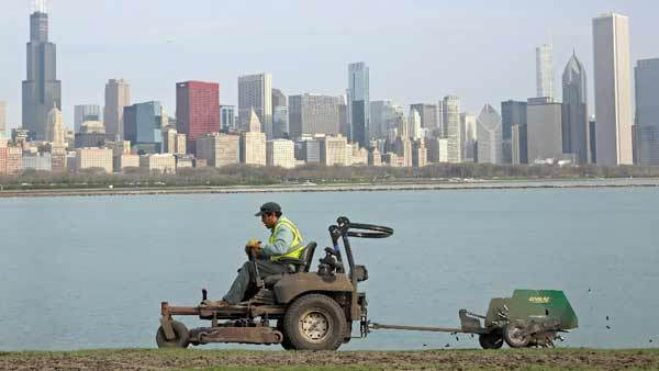 A maintenance worker aerates the soil in front of the Adler Planetarium Tuesday morning.