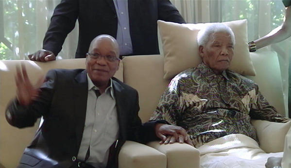"In this image taken from video, South African President Jacob Zuma, left, sits with 94-year-old Nelson Madela at Mandela's home on Monday. Mandela was recently hospitalized for a recurring lung infection. Zuma said he found the Mandela ""in good shape and in good spirits,"" although the video did not appear to confirm that."