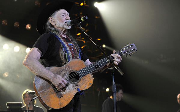 Willie Nelson performs during Keith Urban's We're All For the Hall benefit concert at Bridgestone Arena on April 16 in Nashville.