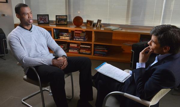 NBA center Jason Collins, left, spoke to ABC News' George Stephanopoulos on Monday night after becoming the first active male athlete in a pro team sport to publicly come out as gay.