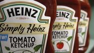 Heinz shareholders on Tuesday overwhelmingly backed an acquisition by Warren Buffett's Berkshire Hathaway and 3G Capital, a private equity firm.