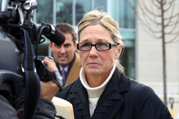 Rita Crundwell, former comptroller for the City of Dixon, is lead away by her attorney, Paul Gaziano, following Crundwell pleading guilty in Federal Court in Rockford in November 2012.