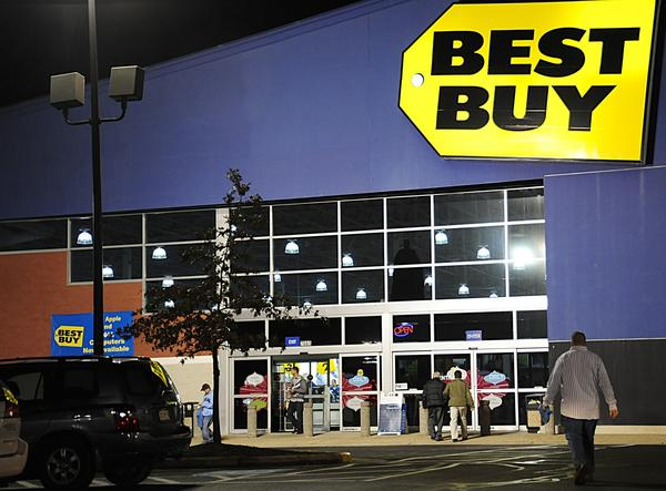 Best Buy is streamlining its operations in the U.S. and selling its stake in a joint venture in Europe. Above, a Best Buy in store in Manassas, Va.
