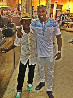 Former NFL receiver Chad Johnson, right, bought his new friend -- a homeless man named Robert who goes by the name Porkchop -- some clothes at Urban Outfitters.
