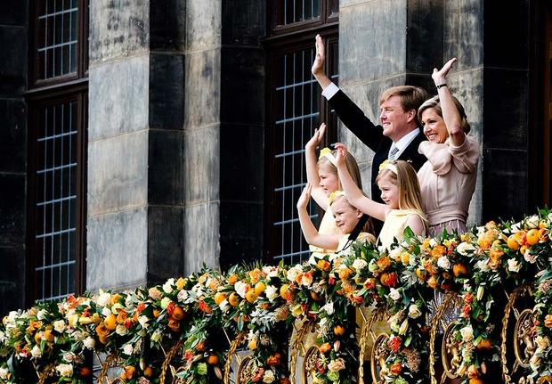 New King Willem-Alexander of the Netherlands, his wife Queen Maxima, right, and their children Princess Catharina-Amalia, front left, Princess Ariane, front right, and Princess Alexia wave to the crowd gathered at the balcony of the Royal Palace in Amsterdam.