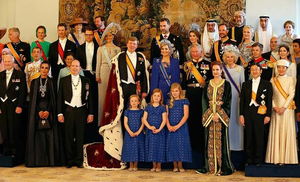 Dutch King Willem-Alexander and his wife Queen Maxima pose for a photo with their royal guests inside the Royal Palace in Amsterdam.