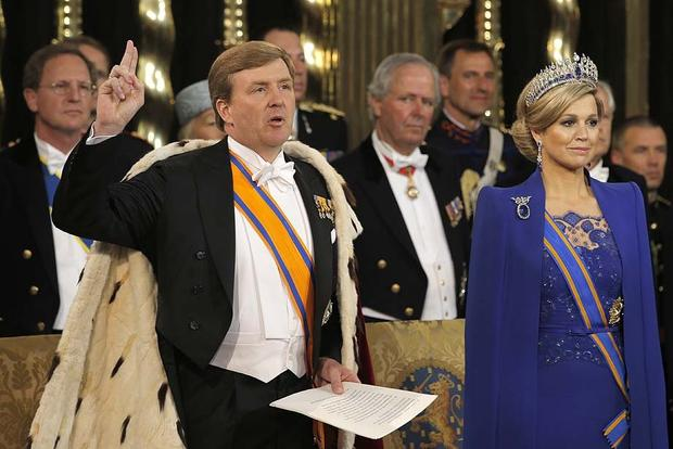 King Willem-Alexander of the Netherlands takes the oath as his wife looks on during his inauguration ceremony in Amsterdam.