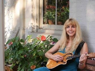 Monique Hill is one of two local minstrels vying for the newly created position of town troubador.
