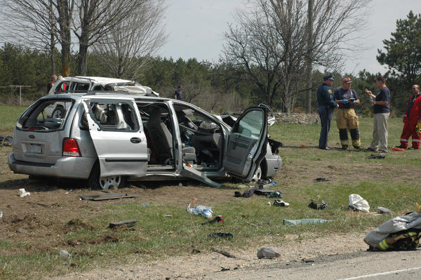 Michigan State Police officials, as well as local law enforcement and emergency personnel, look over the wreckage of a tragic two-vehicle accident that claimed the lives of three people, including a 27-year-old Kalkaska woman, shortly before 11:25 a.m. on Monday, April 29, on County Road 612 in Excelsior Township.