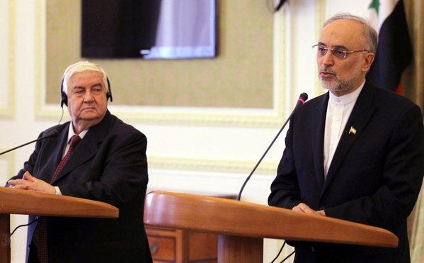 Iranian Foreign Minister Ali Akbar Salehi, right, and his Syrian counterpart Walid Moallem, left, attend a press conference in Tehran on March 2, 2013.