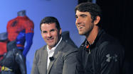 With Michael Phelps on hand, Under Armour pledges new jobs, growth
