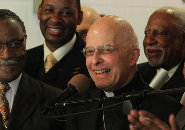 """Surrounded by members of the Interfaith Coalition, Cardinal Francis George speaks out on behalf of restoring the water fee exemption for religious institutions during a press conference at St. Paul Church of God in Christ on Tuesday. """"The lake is a gift from God,"""" said Cardinal Francis George said. More than 100 religious leaders and a handful of aldermen called for a repeal of the water fee imposed on non-profits by the city last year."""