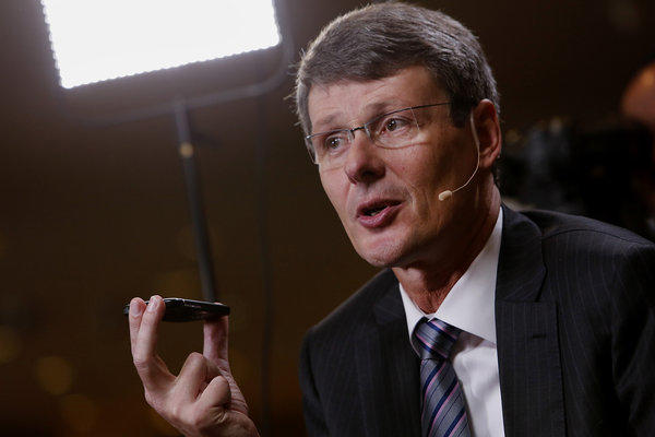 Thorsten Heins, chief excutive of BlackBerry, holds a Q10 smartphone while speaking Monday during a Bloomberg Television interview at the annual Milken Institute Global Conference in Beverly Hills.