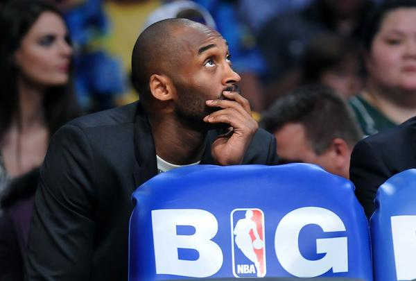 Kobe Bryant is expected to miss at least six to nine months after suffering an Achilles' tear on April 12.