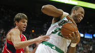 Celtics center Collins grabs a rebound away from  Hawks guard Korver in the first half of their NBA basketball game in Atlanta