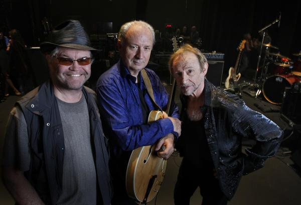 Surviving Monkees band members, from left, Micky Dolenz, Mike Nesmith and Peter Tork, shown in November 2012, will tour more extensively this summer.