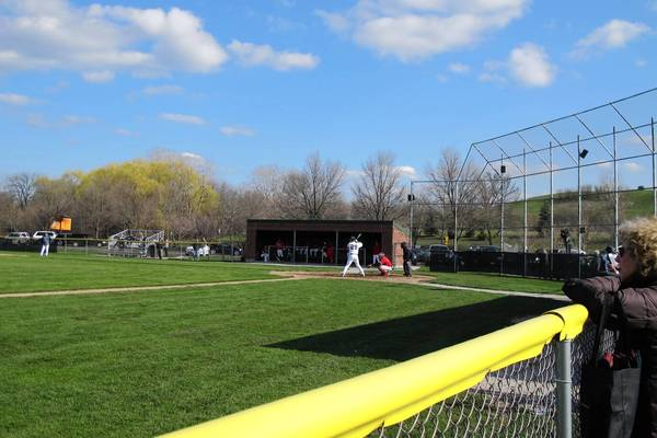 At a recent New Trier High School baseball game, a right-handed batter steps in. New Trier has proposed to build a 50-foot tall net to prevent foul balls from arcing over the backstop onto Willow Road.