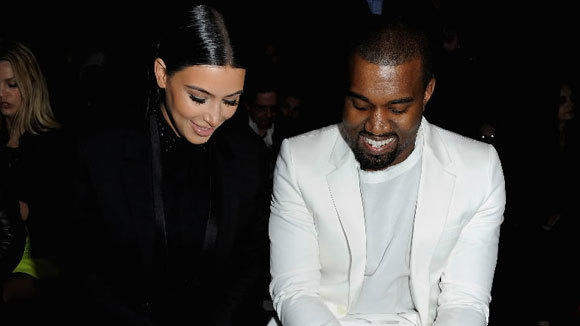 Kim Kardashian and Kanye West attend the Givenchy Fall/Winter 2013 Ready-to-Wear show March 3 in Paris.