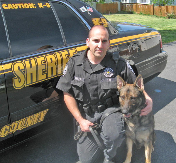 Jefferson County (W.Va.) Sheriff's deputy Cpl. D.C. Tabler is shown with his K-9 partner Veit.