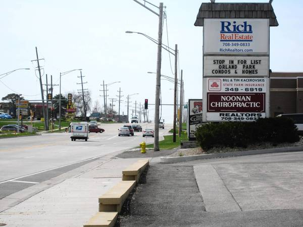 James Noonan of Noonan Chiropractic Clinic, said the La Grange Road widening project will force him to move his sign and lose most of his front parking.