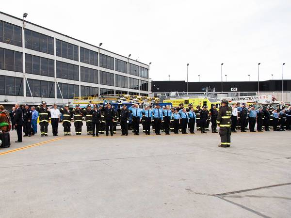Area firefighters stand at attention Saturday as the remains of Kevin Sanders arrived at O'Hare airport Saturday. Sanders, who grew up in the Chicago area, was one of 14 killed in a fertilizer plant explosion April 17 in West, Tex.