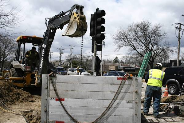 Nicor Gas employees perform preliminary construction work at the intersection of Chestnut Avenue and Waukegan Road on April 25.