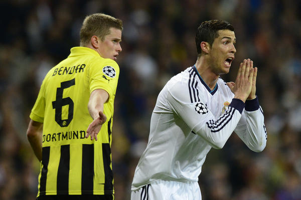 Real Madrid's Cristiano Ronaldo (right) reacts next to Dortmund's midfielder Sven Bender during the UEFA Champions League semifinal.