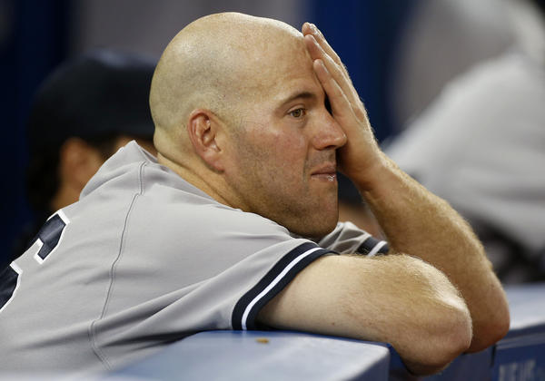 New York Yankees third baseman Kevin Youkilis (36) looks on from the dugout during the game against the Toronto Blue Jays at the Rogers Centre.