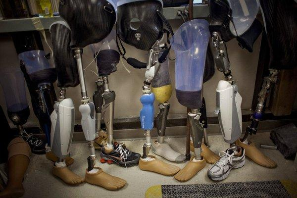 The lifetime cost of losing a limb can run to $500,000, and health insurers often impose strict limits on reimbursement for such care. A new coalition of prosthetics and orthotics makers has said it will step in to help Boston Marathon amputees with little or no insurance coverage.