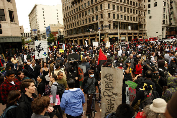 Hundreds of members with the Occupy LA movement crowd the intersection at 5th and Hill streets as part of May Day activities in downtown Los Angeles in 2012.
