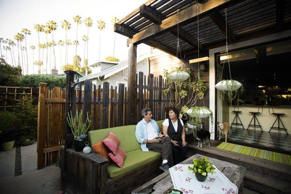"Annette Gutierrez, pictured with husband Gustavo, created an outdoor great room as an extension of the indoor kitchen. ""I wanted it to feel like my front living room so you can walk out and just plop down and relax,"" Gutierrez said. ""We use it all the time."" For a tour of her outdoor living areas, keep clicking."