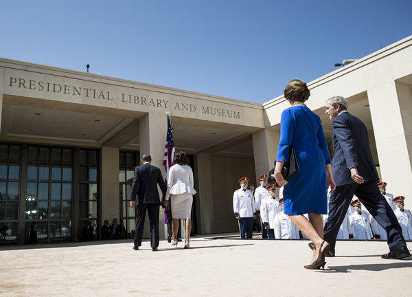 President Obama and First Lady Michelle Obama and former President George W. Bush and Laura Bush depart after the dedication ceremony at the George W. Bush Presidential Library and Museum in Dallas.